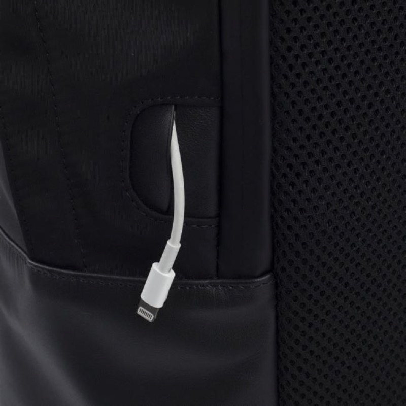 The Classic Backpack from ISM Cable passthrough for quick charging on the go.